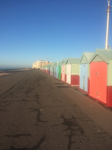 Colourful beach huts by the seaside